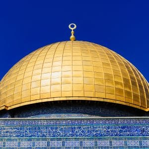 gold dome building under blue sky during daytime